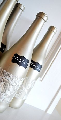 Champagne Lace Chalkboard Table Number Centerpiece~ I can soo do these cheaper...do those mini wine bottles similar and put in flowers for the centerpiece. With pearls dangling as an addition