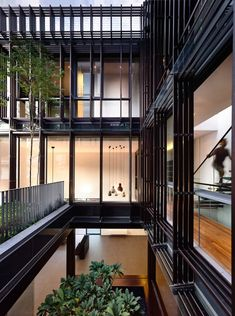 Award-winning Singaporean architecture firm HYLA Architects designed a semi-detached residence in Greenbank Park, Singapore, that centers around a two-storey courtyard. The first level of the courtyard is a timber-frame box with transparent glass .