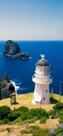 VERIFIED New Zealand this is unmistakably Cape Brett Lighthouse, Southern Bay of Islands, North Island, New Zealand   being the Southern point of the rocky Bay of Islands, Brett Light has a critical task. Many extremely large Cruise Liners visit BOI, over 2,000 passengers, sometimes more, and sometimes two ships on the same day!, navigation is critical       (Research, Verification, Curation & Caption by @BillGP ) .  Bill Gibson-Patmore,  Bill ✔️