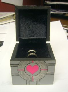 DIY Companion Cube ring box for under $10 | Offbeat Bride. Patrick could totally do this. He's so creative with stuff like this!