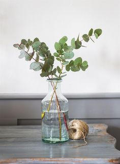 Our small glass bottle vase has been crafted using hand-blown recycled glass making them ideal for flower arrangements or serving refreshments.