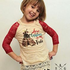 "Kids Love Christmas with My Tribe Burnout with Red Lace Sleeves (SMK3312) $20.00, 60% cotton, 35% polyester and 5% spandex Loose Fit, Size 2/4, 4/6, 6/8, 8/10, and 10/12 Southern Grace Clothing Delivery/Pick up Customers can use the code ""deliver"" to waive shipping Kids' Sizes order HERE:  http://www.mackieshaeboutique.com/apps/webstore/products/show/7146544"