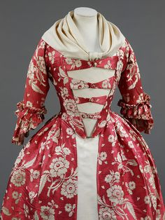 Gown    Place of origin:  Britain, UK (made)    Date:  1760-1769 (made)   1740-1749 (hand woven)    Artist/Maker:  Unknown (production)    Materials and Techniques:  Silk, lined with linen, hand woven and hand sewn    Credit Line:  Given by Mrs H. H. Fraser    Museum number:  T.433-1967    Gallery location:  In Storage