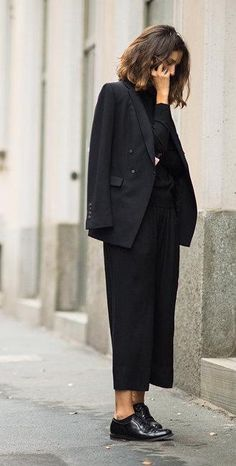 Isabelle Kountoure in a black blazer, culottes, and oxfords