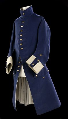 sleeves feature a white boot cuff divided by a three-pointed flap of blue wool. This was known as the 'mariner's cuff' National Maritime Museum
