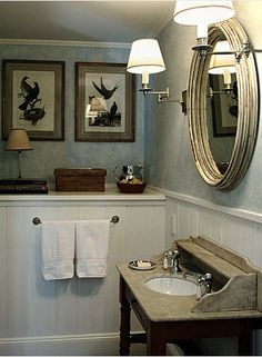 shelf vignette/sconces.  would install a cabinet where towel rack is
