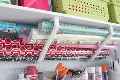 shelf brackets for wrapping paper, rain gutter for ribbon rolls