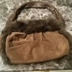 Cute brown suede bag Laundry by Shelli Segal. Genuine cowhide leather bag by Shelli Segal.  Brown w/ rabbit fur trim. Good condition. shelli segal Bags Shoulder Bags