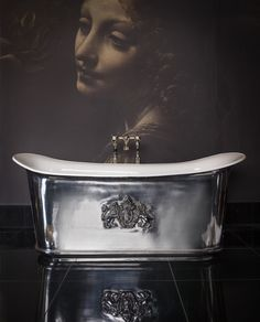 The polished nickel finish of this Catchpole and Rye bath looks great with the enamel interior. #bathroom #design