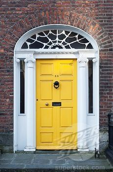 A yellow front door - hmmm...wonder how this would look with our brick?