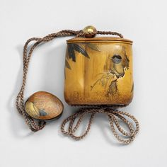 Pouch by Shibata Zeshin, ojime (bead), and netsuke (toggle) by Ikeda Sensa  Inrô: Shibata Zeshin (1807-1891); Netsuke: Ikeda Sensai (1870-1945).  Bamboo, lacquered and gilded in maki-e and kirigane techniques, with brass ojime  Centimetres: 5.9 (length), 3.7 (height), 6.2 (width)  19th to mid 20th century AD. ROM Images