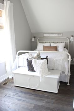 Grey Farmhouse Bedroom with metal bed and white bedding - Home Bunch blog