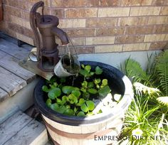 Beautiful backyard pond ideas for all budgets | Whiskey barrel pond with fountain