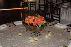 Orange circus roses massed arrangment in our footed compotes