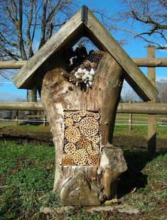 This creative bee hotel uses bamboo and holes of the proper sizes drilled in logs to attract solitary bees. And it's kind of fun to look at too.