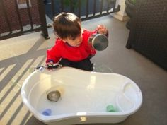 Make your own water table out of a baby bathtub! | #BabyCenterBlog