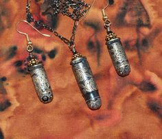 Bullet jewelry - black gold bullet pendant and bullet earring set - etched bullet casings. $57.00, via Etsy.