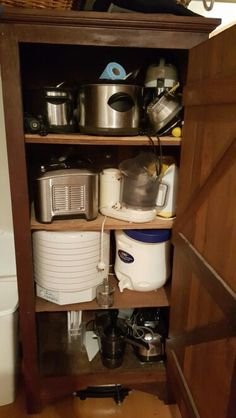 Infrequent use appliances: Bottom shelf: mandolin, juicer 2 fr bottom: dehydrator, vacola preserving kit 3 fr bottom: ice cream machine, food processor, popcorn machine  Top: 2 crock pots, hand mill, soy machine