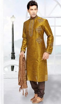 Wear this Indian mens kurta, pyjama set in brocade, shaded green to give you traditional look. The brilliant attire creates a dramatic canvas with moti, patch, resham, stones and velvet patch work. Brocade might vary from actual image. #embroideredworkkurtas  #embroideredbuttadesignkurta  #onlineembroideredkurtapajama