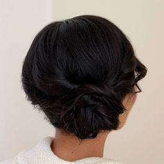 messy side low bun for shorter hair
