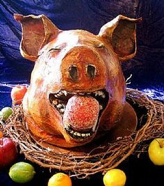 I could see this pig head with a cute little black mask for Halloween.