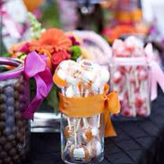 Sweeties in jars with bright ribbon. Cute and inexpensive favours idea.