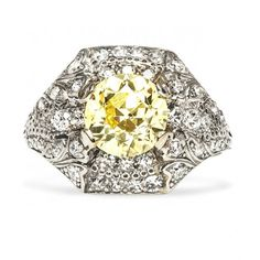 Sun Valley is a striking Art Deco engagement ring featuring a 1.77ct Old European Cut Fancy Yellow diamond in a bombe style platinum setting studded with diamonds. All we can say is WOW! TrumpetandHorn.com