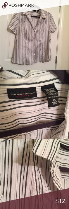 New York & Company top Cute lightweight button up shirt with slight taper at waist, white with black and silver stripes. Very flattering, great on its own or under a blazer. Size XL New York & Company Tops Button Down Shirts