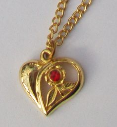 A gold tone heart pendant and chain necklace with embedded faux ruby decoration Measurement the heart pendant is approximately 1 3 cm x 1 5 cm The Gold Necklace, Pendant Necklace, Ruby Stone, Valentines Jewelry, Heart Jewelry, Stone Pendants, Jewellery, Chain, Decoration