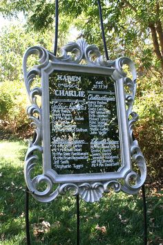 Platinum scroll framed vintage mirror seating chart.