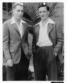 1940s teenage fashion boys. Boys adopted men's clothing for their wardrobe but put on a more casual, relaxed, spin on it. Their styles were not as extreme as the girls but none the less an important shift in fashion history.