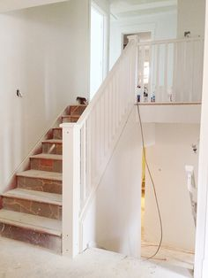 AFTER: dark split-level staircase opened up - Laurier Heights home by In The Fun Lane