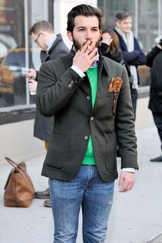 Gloves in the front pocket of the popped-collar blazer...bold look.