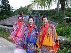 Ryukyu Hospitality Young women dressed in traditional Okinawan/Ryukyuan kimonos pose for a shot. Ryukyu Mura, Yomitan-son, Okinawa, Japan. Photo by Robert Mallon