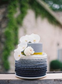 Ruffled midnight ombre cake: http://www.stylemepretty.com/2015/05/09/the-prettiest-ombre-wedding-details/