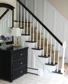 Black treads and railing, white risers and spindles and board batten, with seagrass runner... exactly what i want