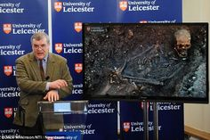 Confirmed 'beyond reasonable doubt': Lead researcher Richard Buckley for the first time shows the remains of King Richard III as they appeared in the rough grave found in the Grey Friars car park.