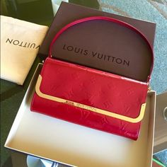 % Authentic Red Rossmore LV clutch. In very good condition. This bag can be use of clutch or shoulder bag. . It comes with the box and dust bag. If you're interested pls message me for more pics at 510-229-8576. Thanks. Louis Vuitton Bags Shoulder Bags