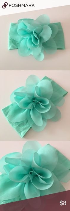 Mint green flower headband NWOT. Has a tiny mark on the back barely noticeable as shown on the last picture. Accessories Hair Accessories