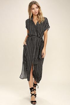 The Desire Lines Black and White Striped Midi Dress will lead the way to a stylish, laid-back look! Black and white striped woven rayon forms a collared neckline and short sleeves atop a button-up bodice with tying waist sash. Midi skirt has front and side slits.