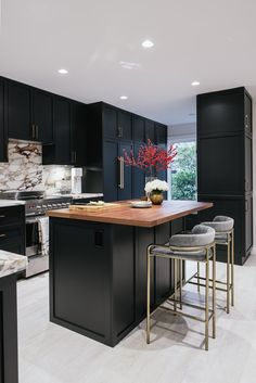 From black countertops to black cabinets to black flooring, we've definitely been lured to the dark side when it comes to our cook spaces. Here are 10 dreamy culinary spaces that have nailed the trend. #hunkerhome #blackkitchen #kitchenideas #kitchenisland #kitchen