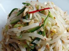 sukjunamu-bean sprout salad quick boil sprouts and drain. cut cucumber into fine strips. Combine with-1 clove of minced garlic, 1 chopped green onion, ½ ts salt, 1 ts sesame oil, and 1 ts sesame seeds to the mixing bowl.Mix well by hand. Serve with rice http://www.maangchi.com/recipe/sukjunamul