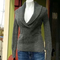 Amazing Grey Sweater Extremely comfortable.  Has two front pockets and lots of stretch. Material is wool and acrylic. LOFT Sweaters Cowl & Turtlenecks