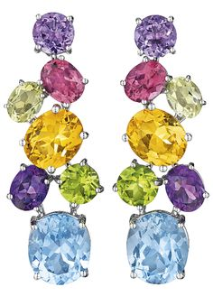 A Pair of Multi-Gem Ear Pendants by Asprey. Each suspending an oval-cut blue topaz, from a line of oval and circular-cut amethyst, peridot, citrine and pink tourmaline, mounted in 18K white gold, length 2 inches.Signed 'Asprey' 'Italy'. Via Philips.
