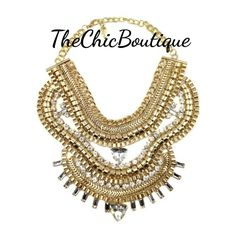 This is a beautiful statement piece. It is a gold colored necklace with clear crystal stones. Very stylish necklace.  Fast and free shipping in the U.S. | Shop this product here: http://spreesy.com/TheChicBoutique/184 | Shop all of our products at http://spreesy.com/TheChicBoutique    | Pinterest selling powered by Spreesy.com