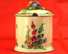 hollyhocks and butterflies mustard pot  crown staffordshire art deco china