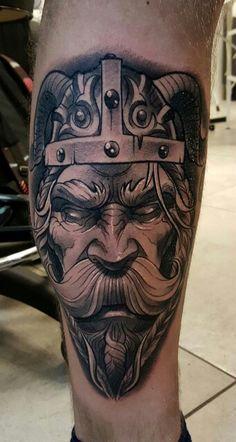 Black and white Viking tattoo on leg