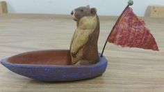 Check out this item in my Etsy shop https://www.etsy.com/listing/288694927/ceramic-marmot-in-boat-with-sari-pennant