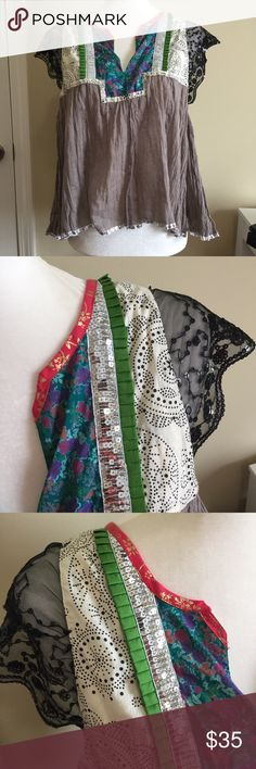 FREE PEOPLE XS Sheer Blouse Top Festival Sparkle This top would be great for summer concerts and festivals! It has a small spot shown in pictures Free People Tops Blouses