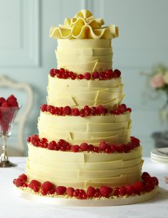 This 4 tier white chocolate wedding cake is smothered in chocolate ...